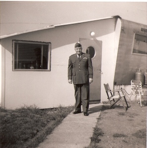 My father, standing in front of our trailer on Chambley AFB. Believe it or not, officers quarters.
